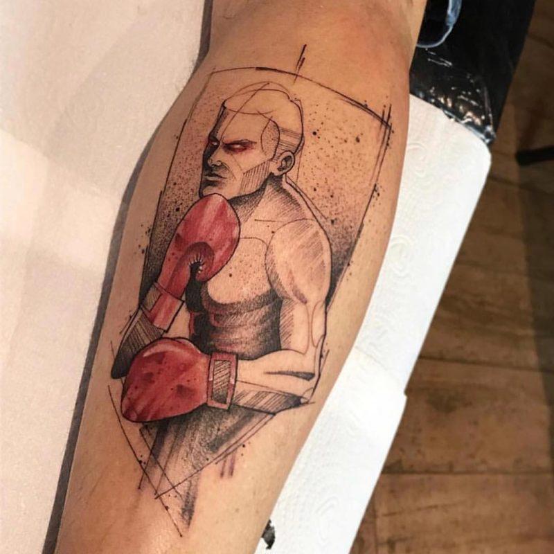 Pugilista tatuado al estilo minimalista
